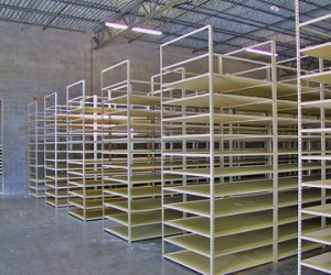 empty rivet shelving in a warehouse