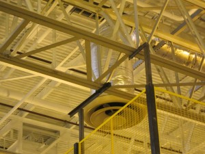 Wire partition attached to ceiling for safety and security