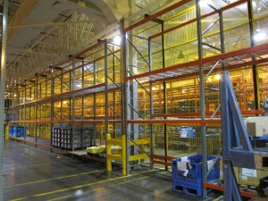 Shelving Inc Pallet Racking with a wire partition back drop