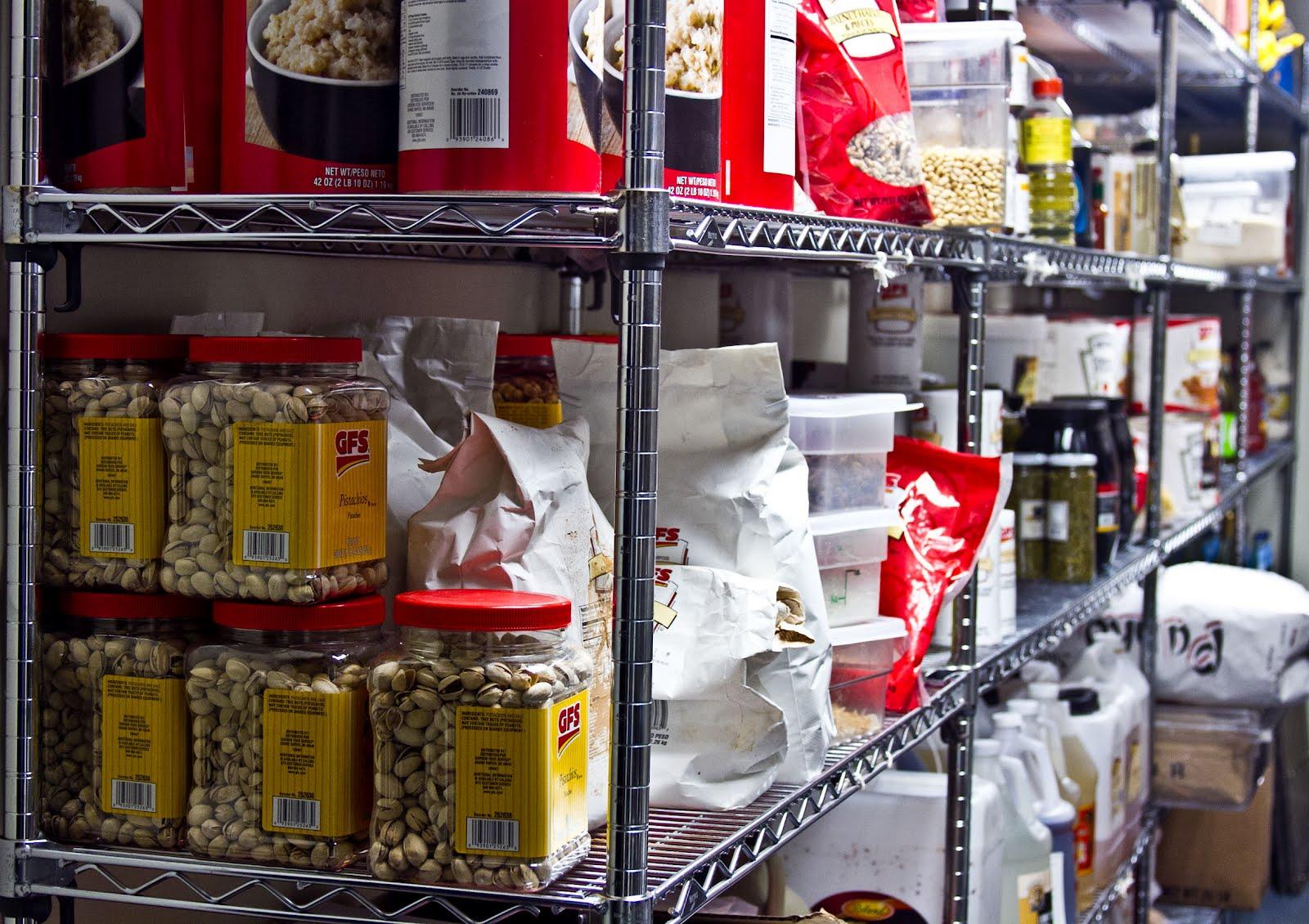 An upscale Italian restaurant's pantry stocked full using a 5 shelf unit.