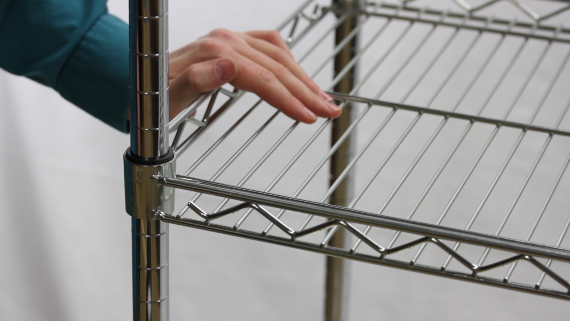 hand on shelf ... & How to Disassemble Wire Shelving - The Shelving Blog