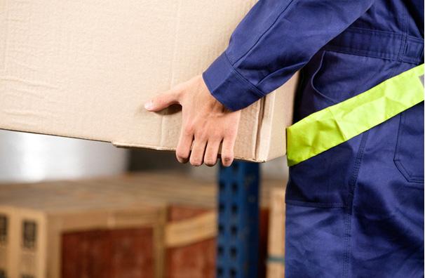 Warehouse Worker Lifting Box