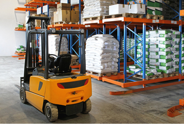 yellow forklift in distribution center