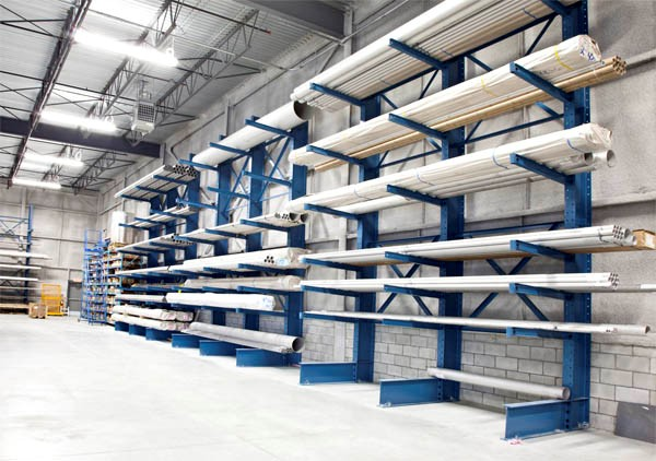 cantilever racking in warehouse holding pipes