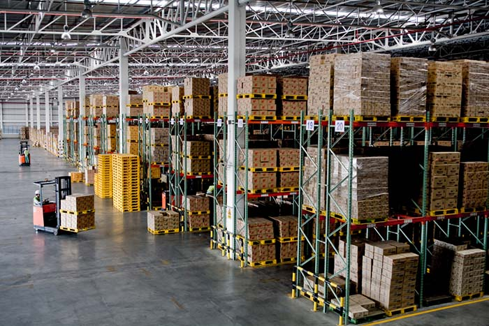 Forklifts Working in Warehouse