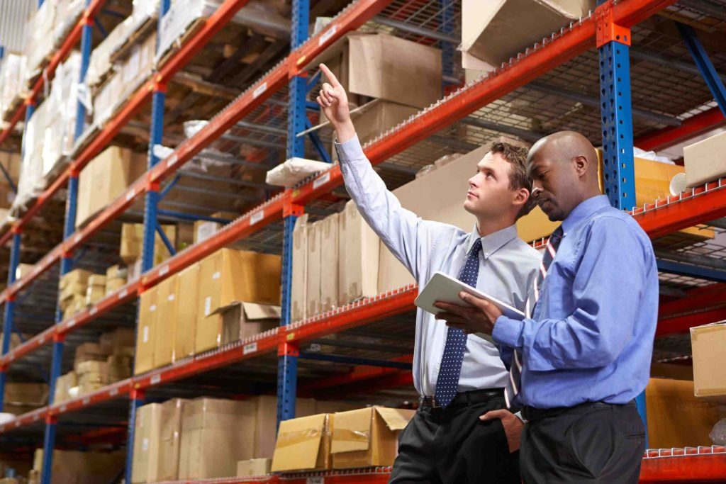 Two men inspecting warehouse