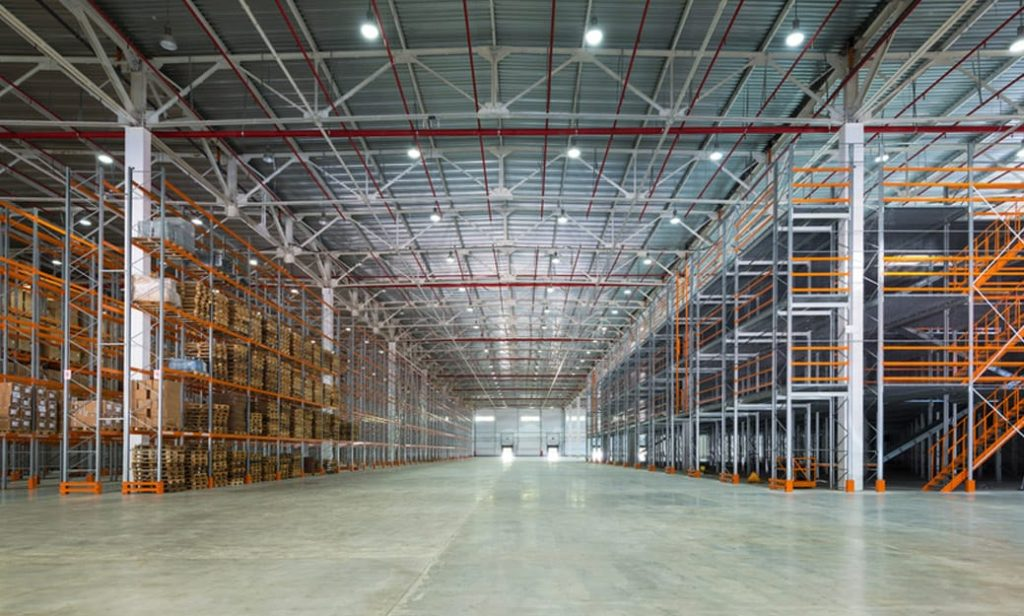 Empty shelving in large warehouse
