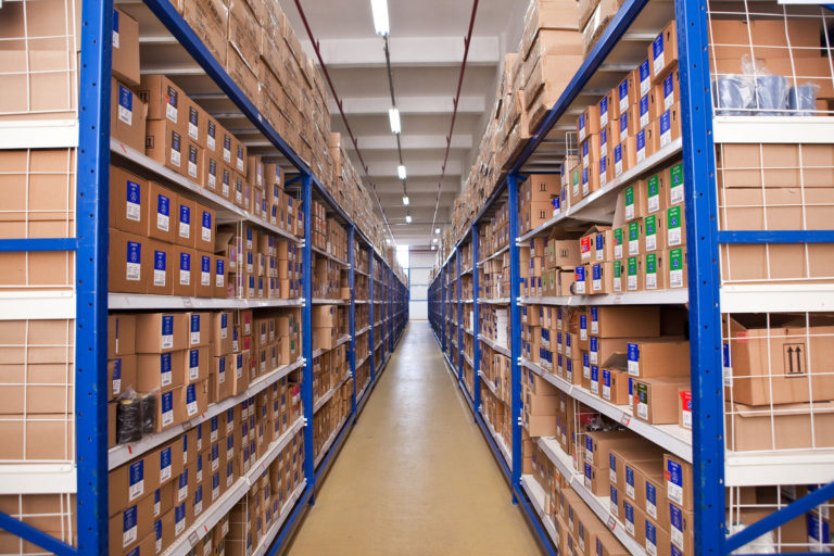 Warehouse with boxes on shelves receding