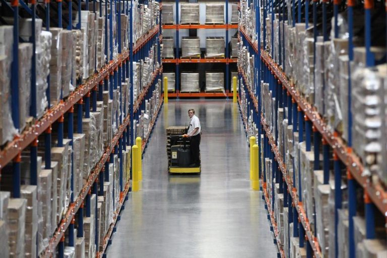 driving hi-lo in warehouse with racking