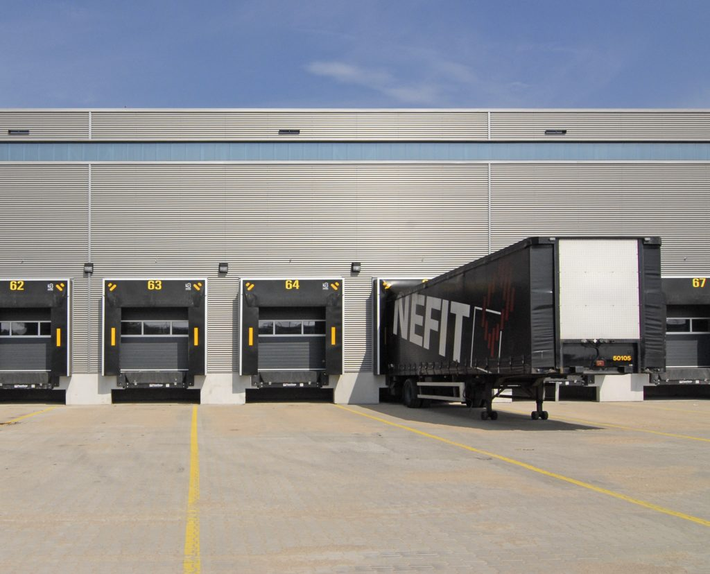 Black truck at a loading dock