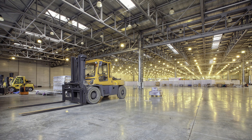Forklift parked in a large warehouse