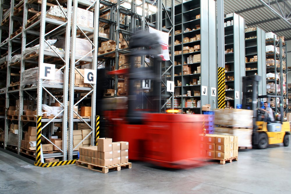 Forklift driving in a warehouse