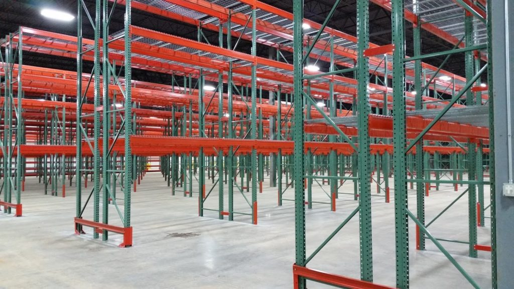 empty red warehouse pallet rack shelves